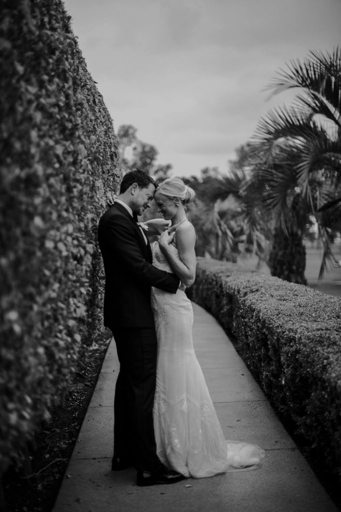 bride and groom embracing near hedge hilton la jolla torrey pines