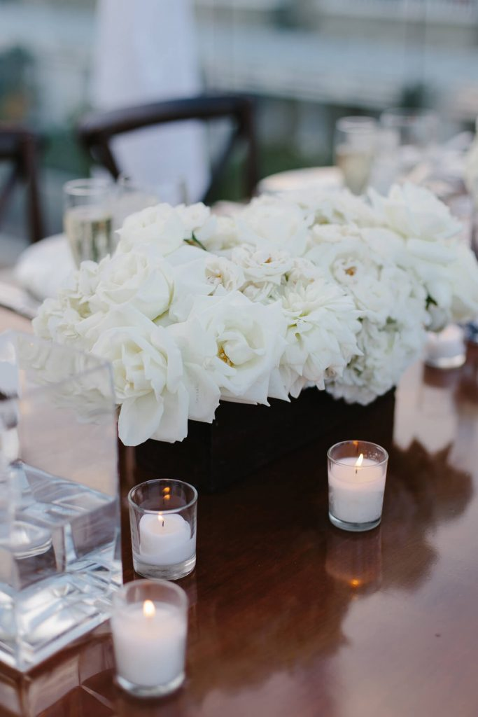 white flowers in wooden holder centerpiece lauberge del mar