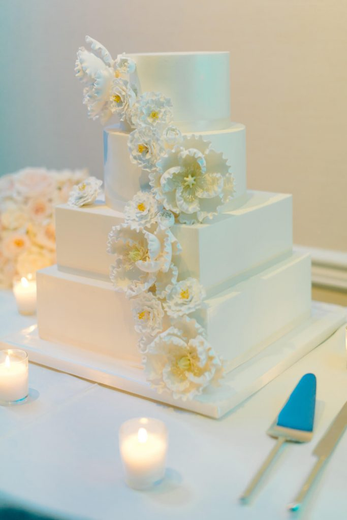 four tier wedding cake with floral decorations