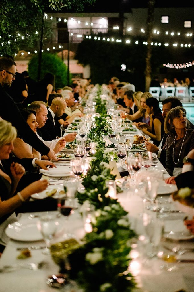 long dinner table next to pool colony palms hotel wedding