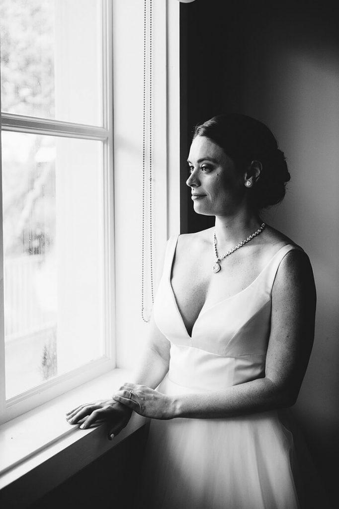 bride posing by window la valencia hotel wedding