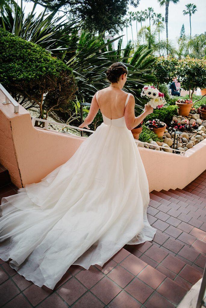 bride walking down steps to la valencia hotel wedding