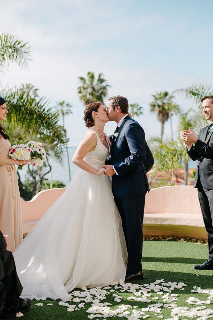 bride and groom kiss la valencia hotel wedding