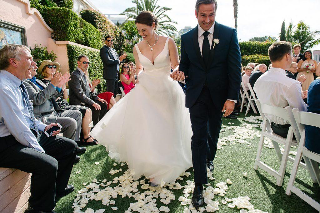 bride and groom walk down aisle la valencia hotel wedding