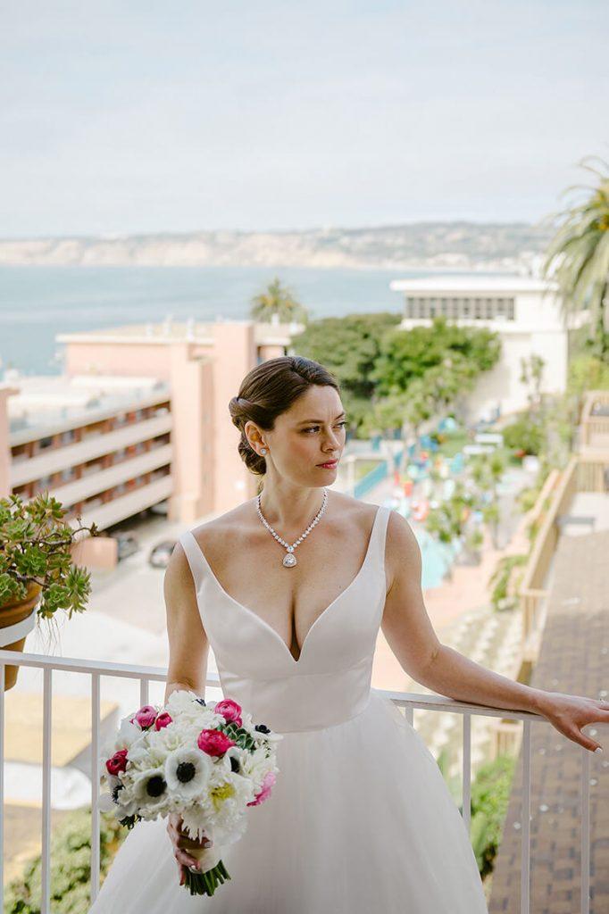 bride posing on balcony la valencia hotel wedding