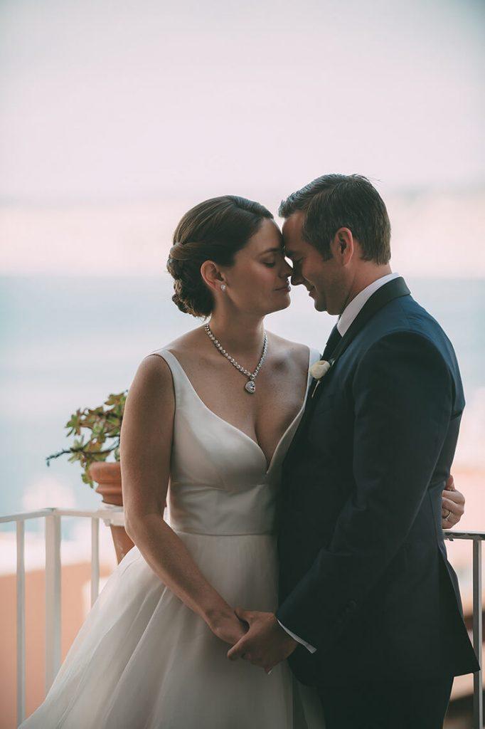 bride and groom embrace on balcony la valencia hotel wedding