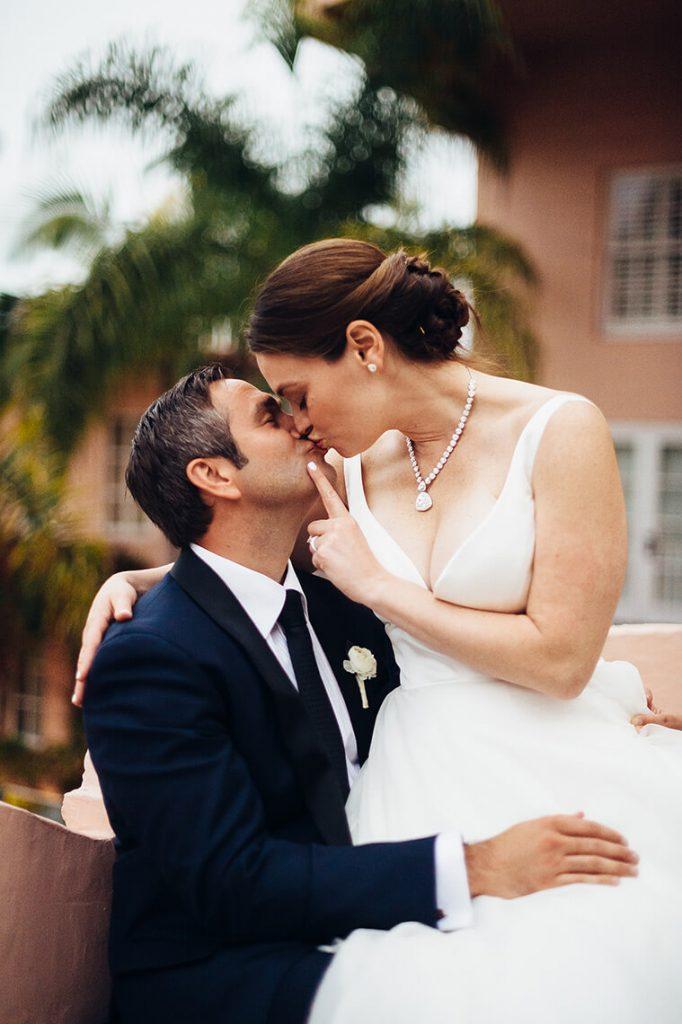 bride and groom kissing on el jardin patio la valencia