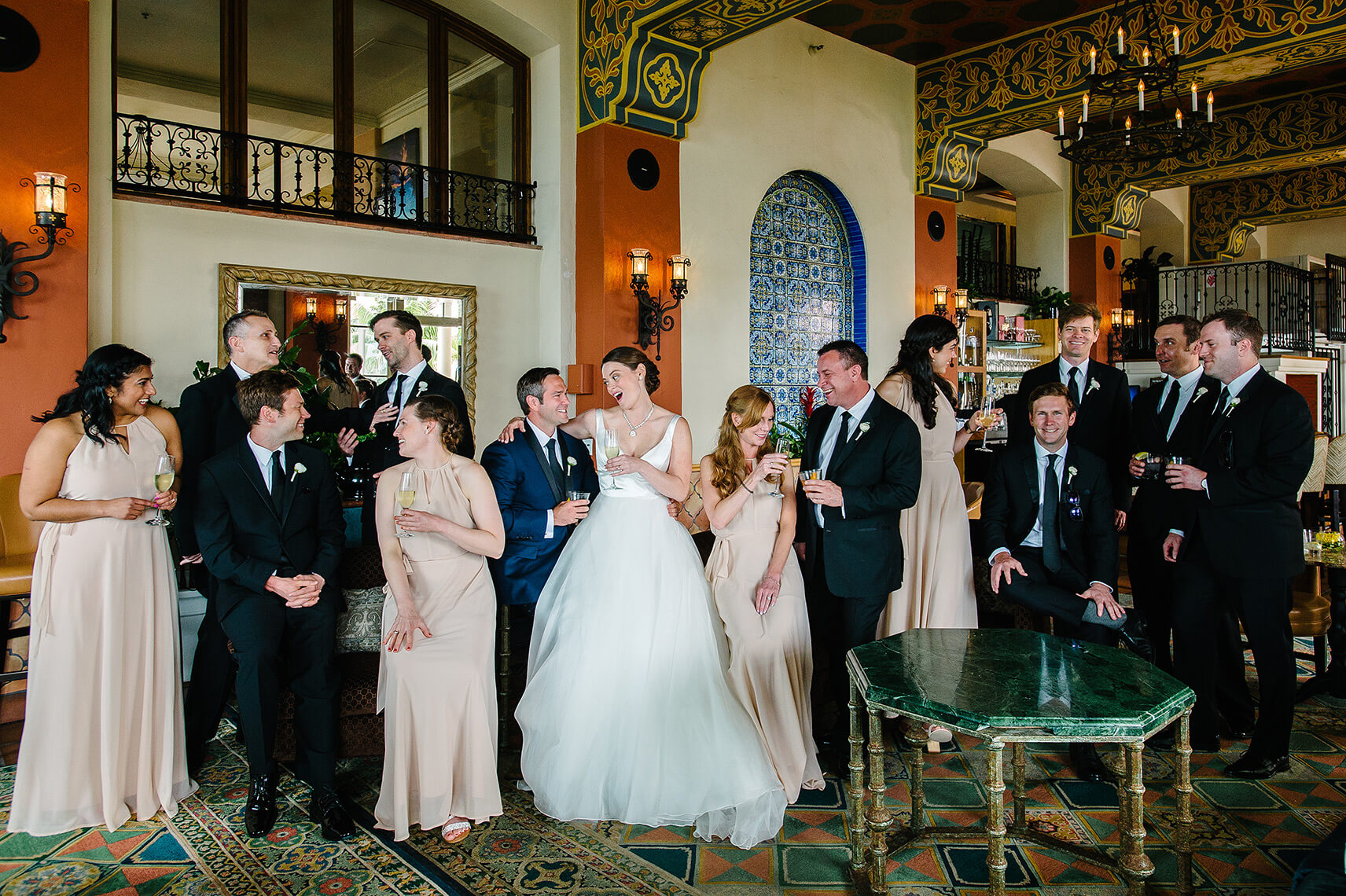 bridal party gathers for group picture in bar at la valencia hotel in la jolla