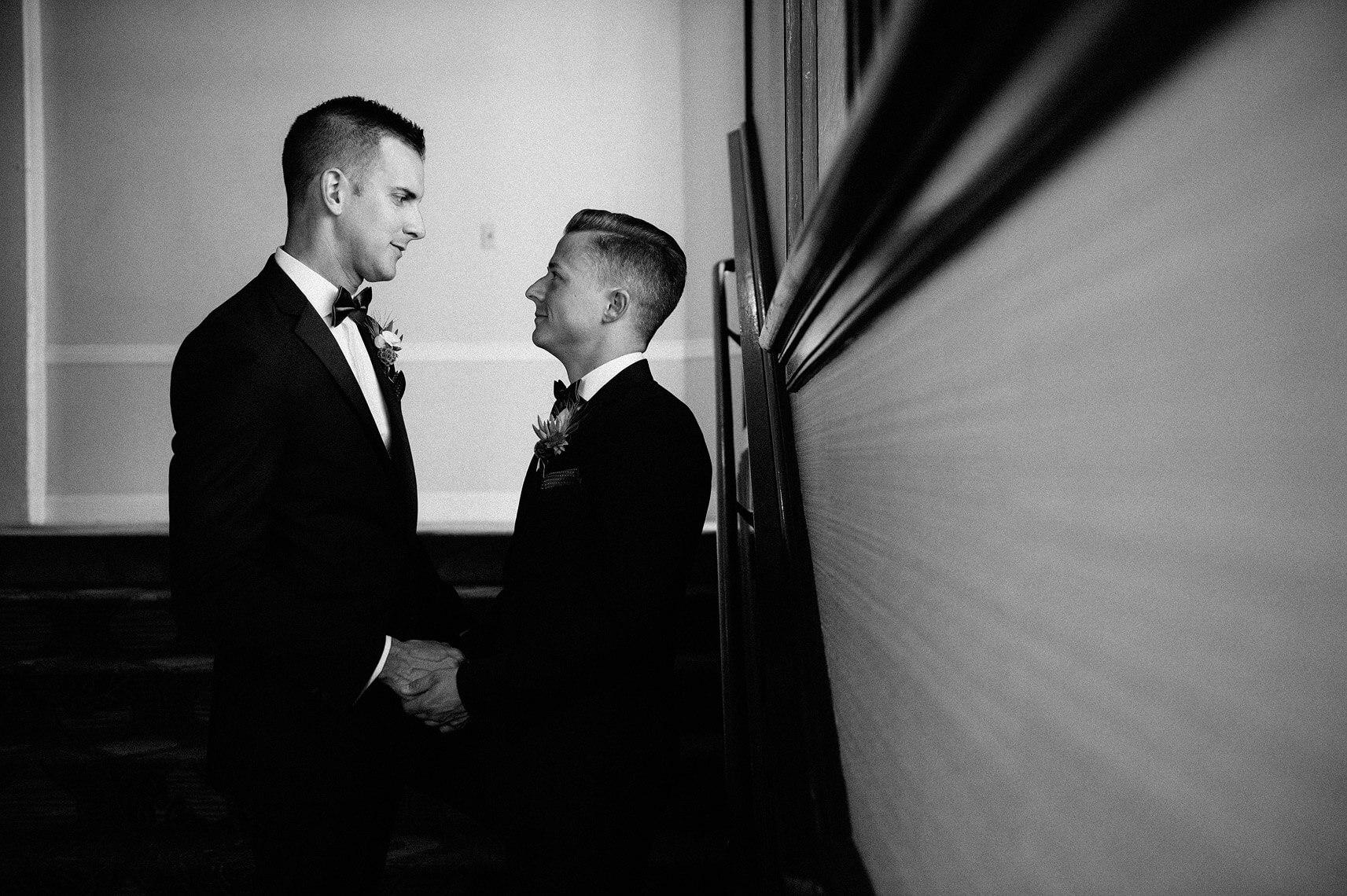 two grooms holding hands hotel del coronado