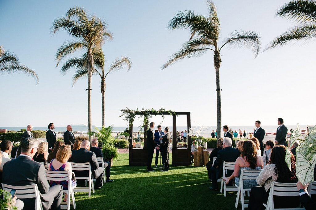 two grooms at altar same sex wedding windsor lawn hotel del coronado