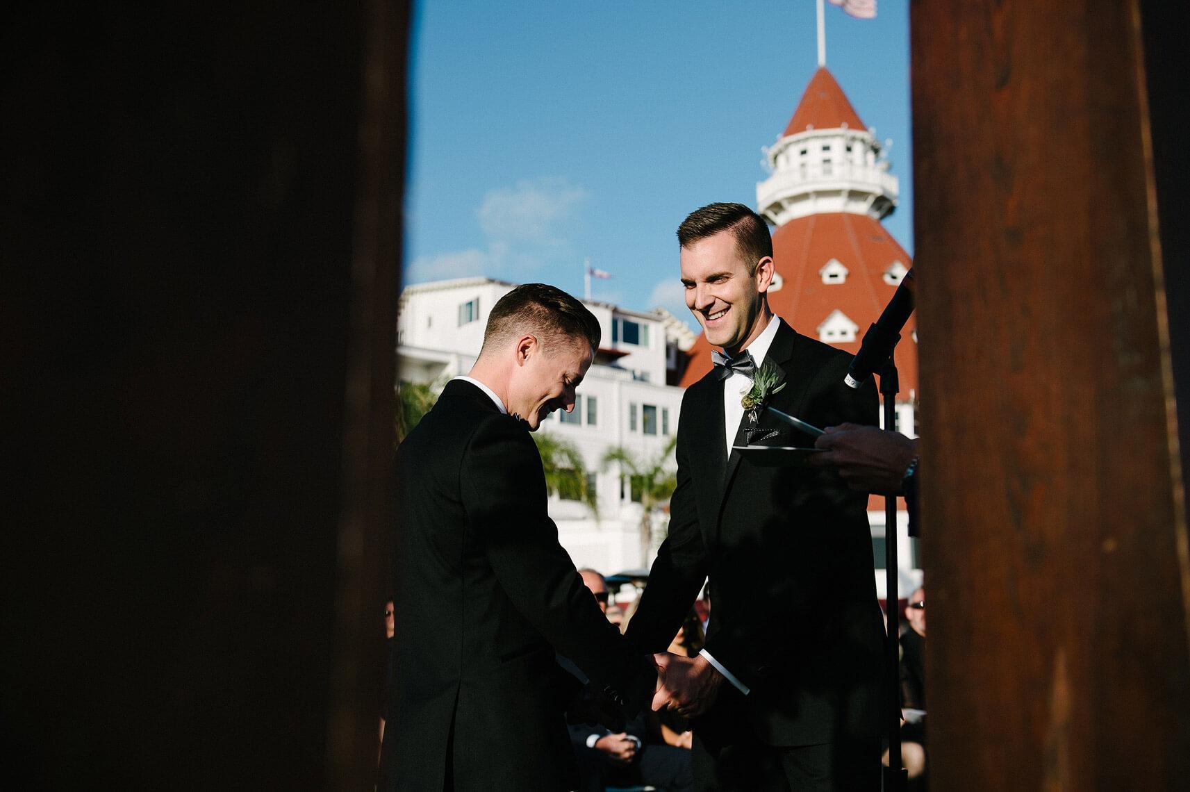 two grooms laughing same sex wedding ceremony hotel del coronado