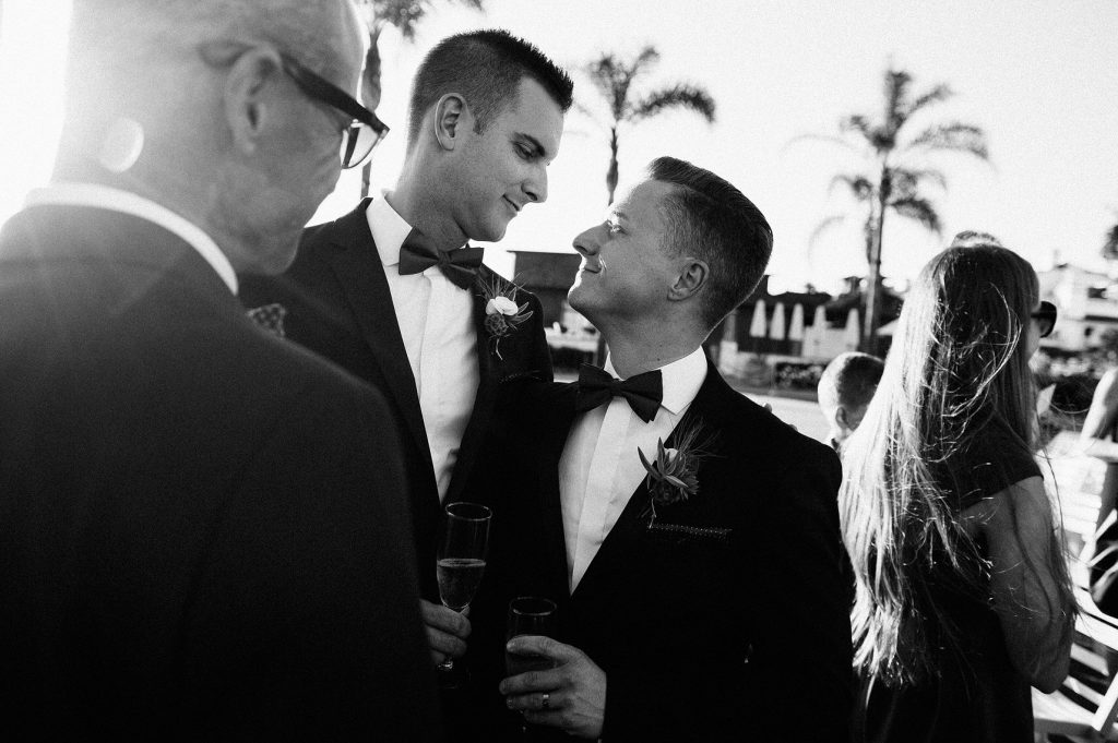 two grooms looking into each others eyes hotel del coronado