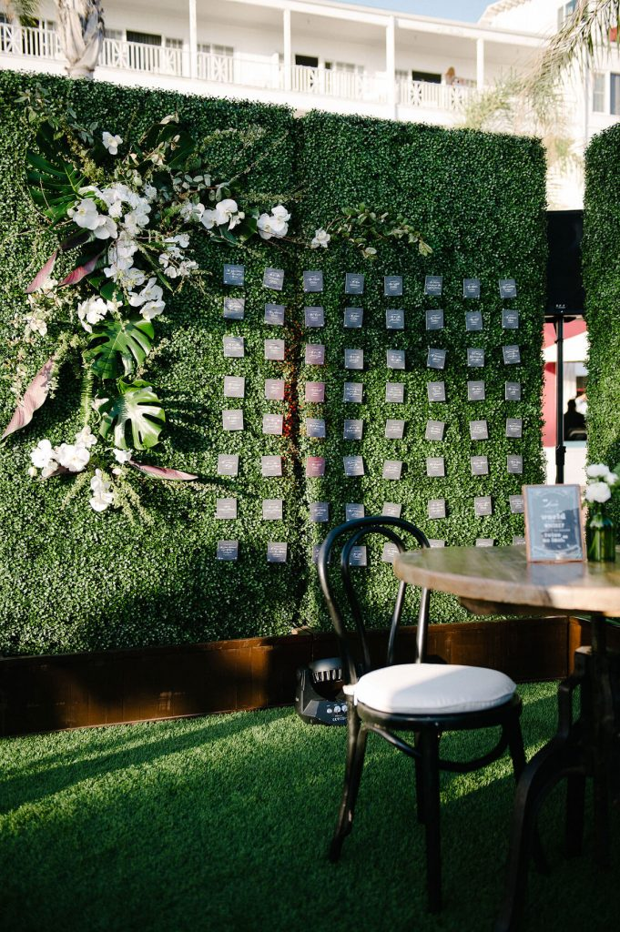 ivy wall with escort cards hanging windsor lawn cocktail hour hotel del