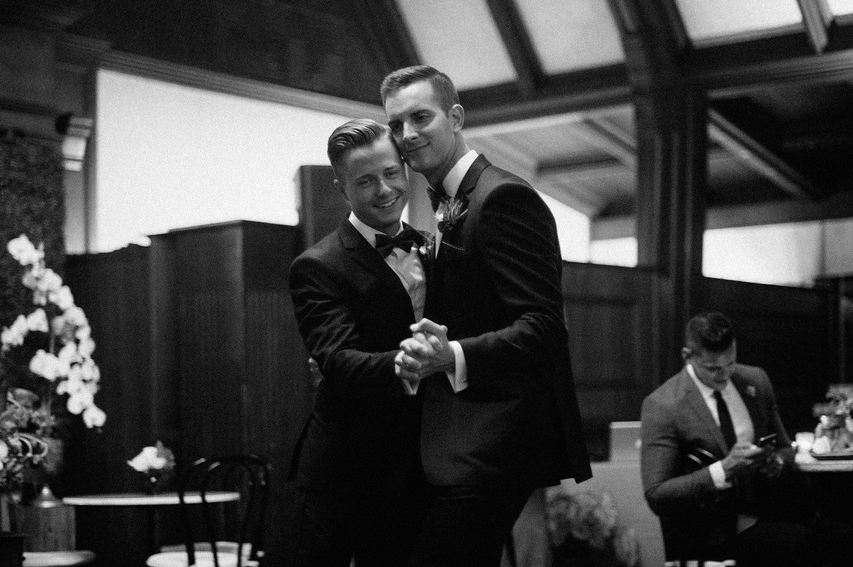 two grooms dancing same sex wedding