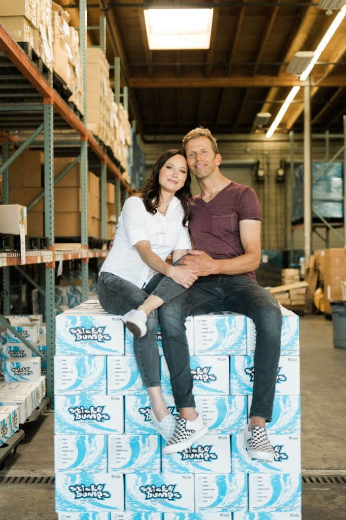 couple posing on pallet of surf wax