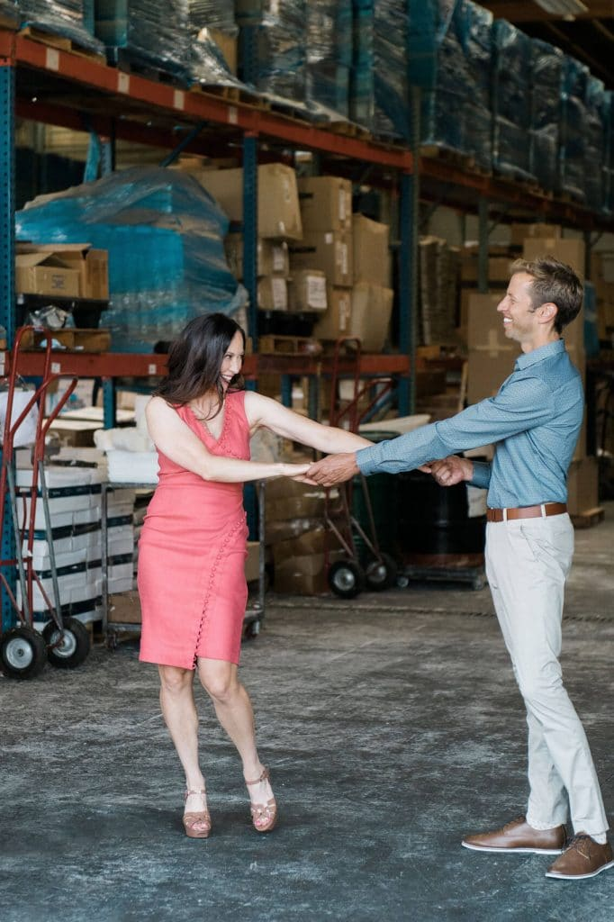 couple dancing in warehouse industrial engagement photo