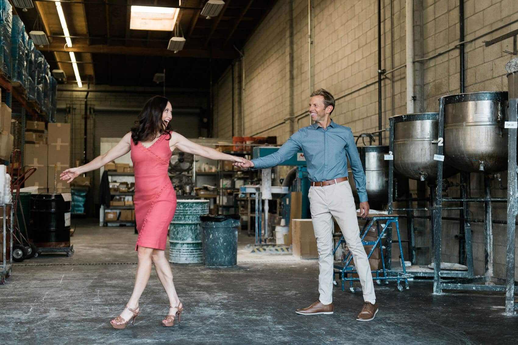 couple dancing in surf wax factory on their industrial engagement photo session