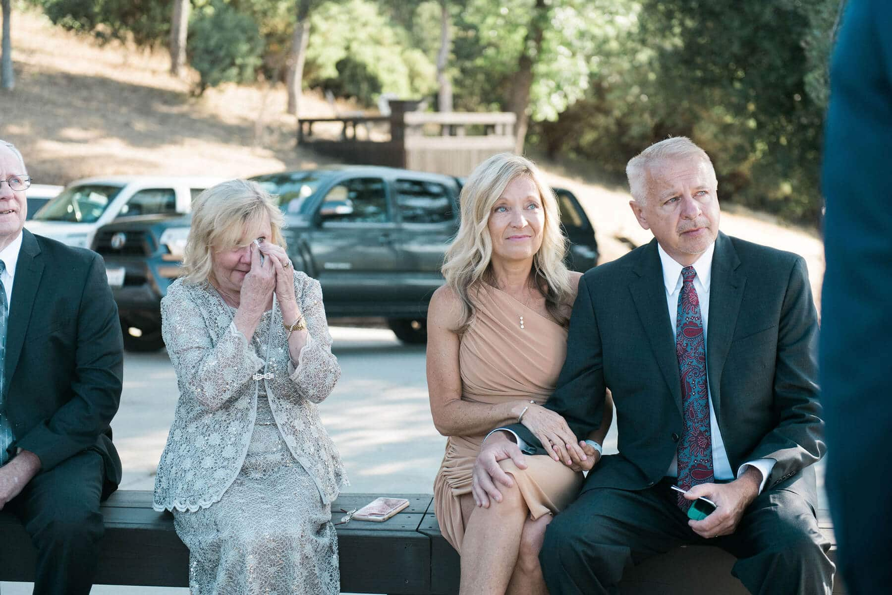 emotional parents watching bride and groom during intimate yosemite elopement