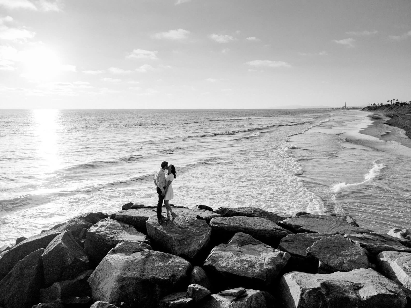 drone photo of a couple embracing on jetty during ponto beach engagement photo session