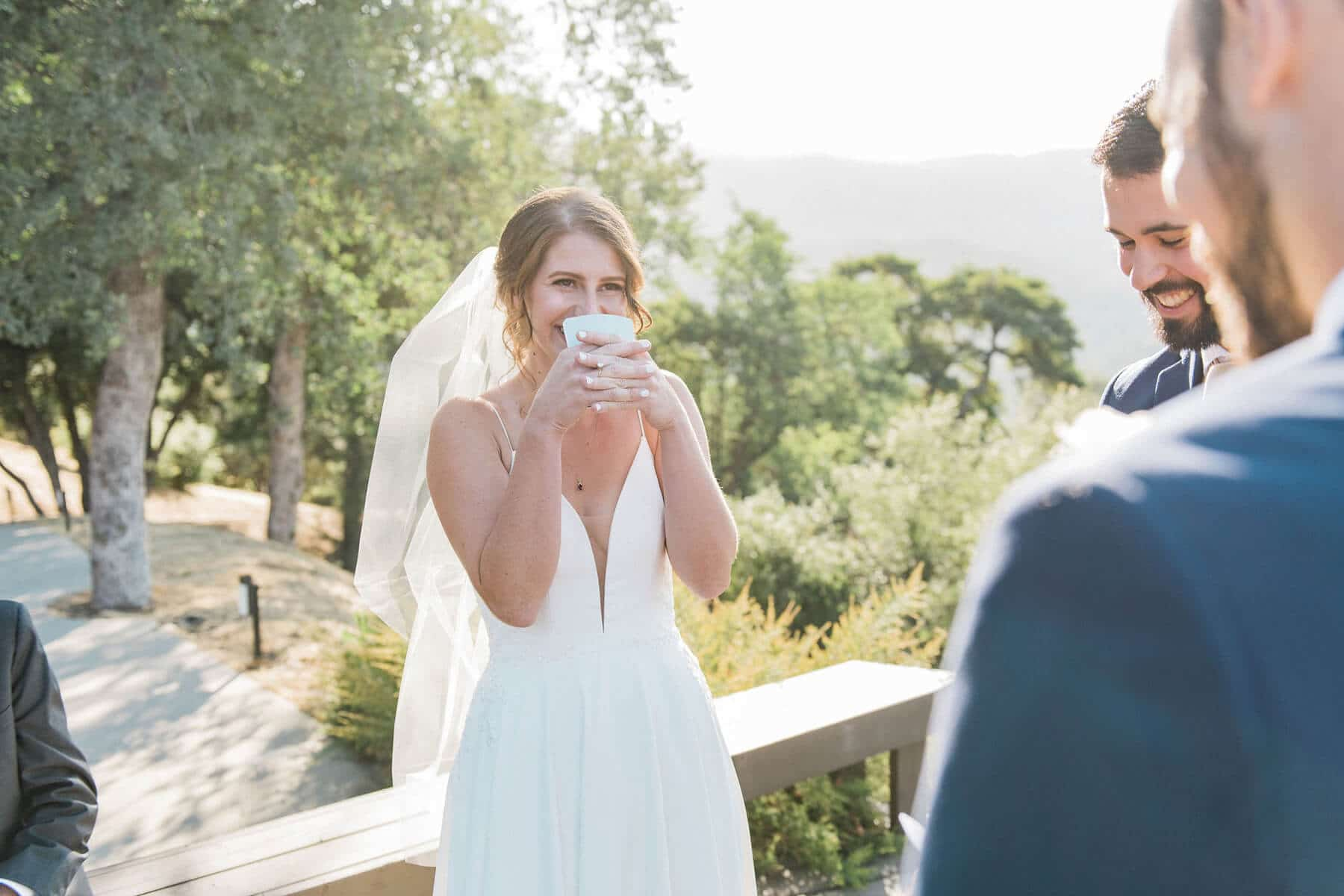 groom laughing and reading vows yosemite adventure elopement