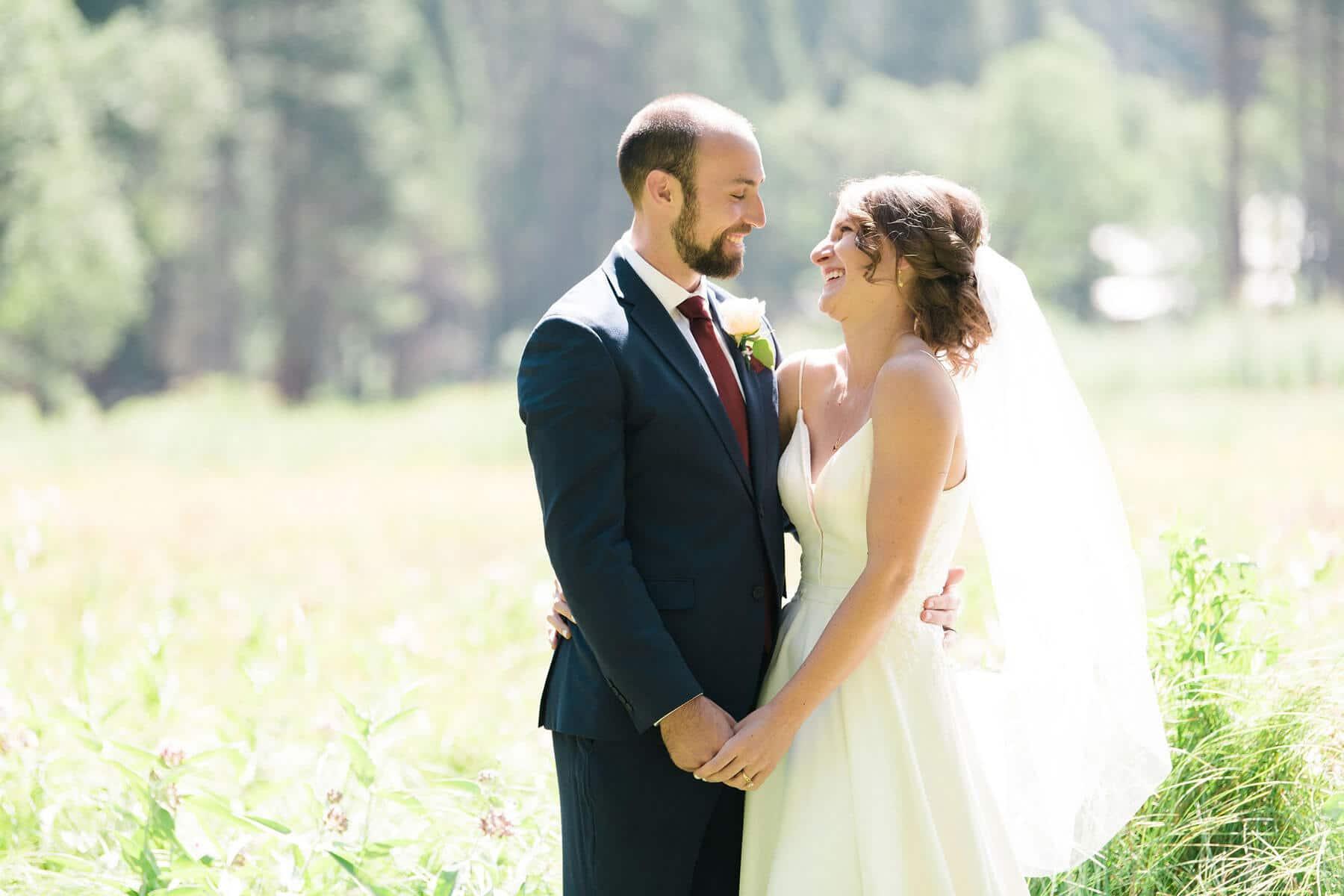 bride and groom laughing ahwahnee meadow yosemite adventure elopement