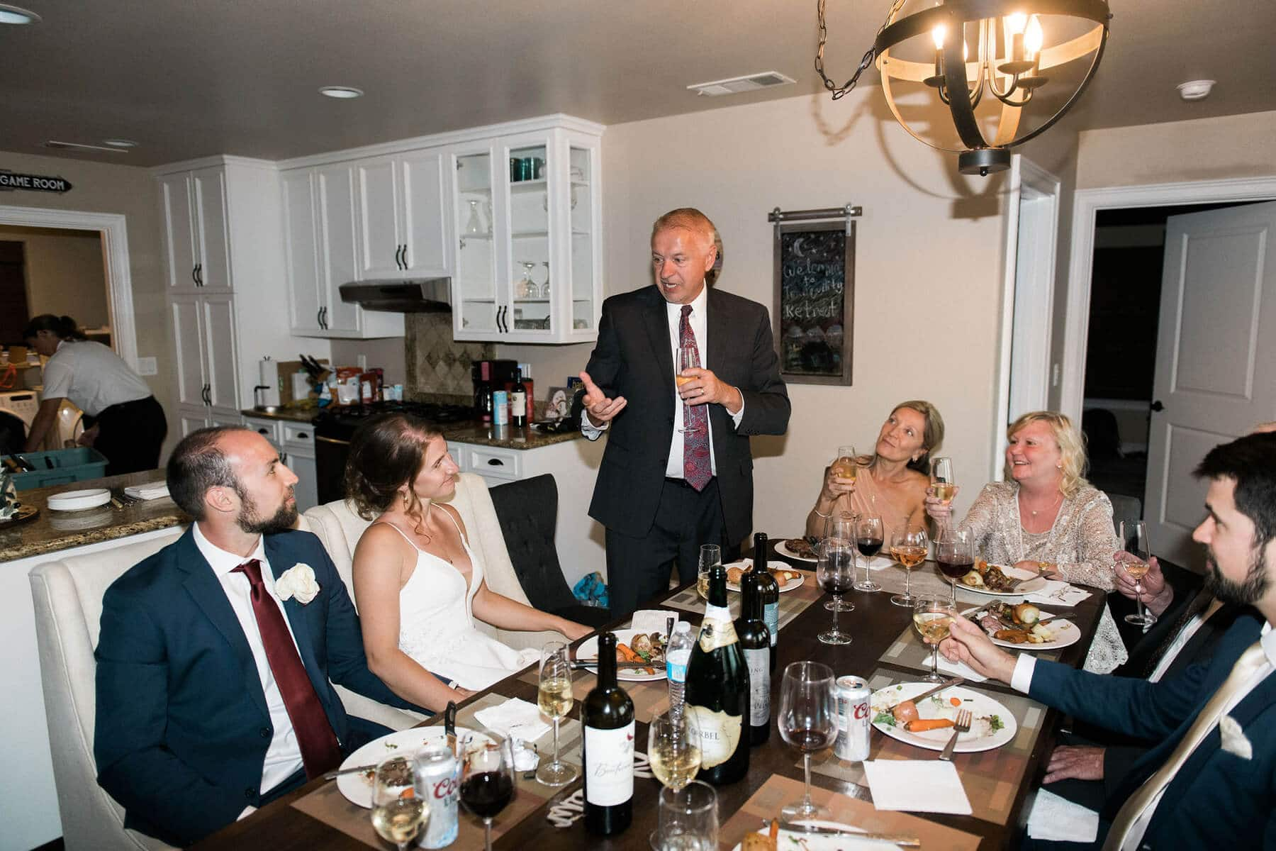 father of bride shares toast during intimate wedding reception at private residence in oakhurst california