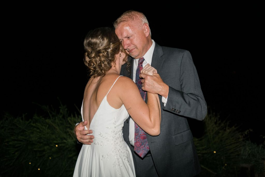 father cries while dancing with bride daughter