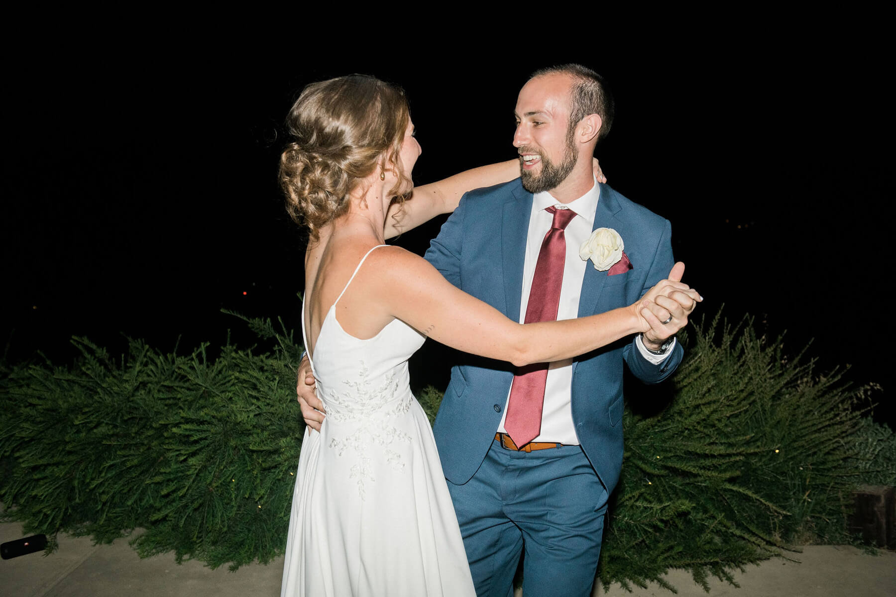 bride and groom doing first dance at intimate wedding reception in oakhurst