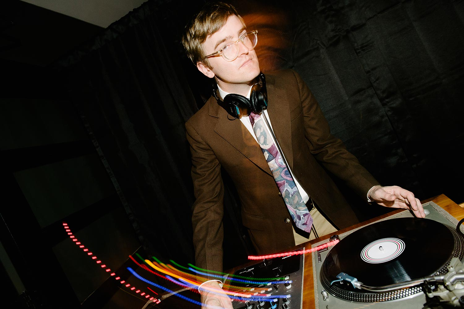 wedding dj spins records on turntable